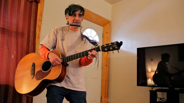 Joe Genaro, better known as Joe Jack Talcum of the Dead Milkmen, performs the folk song Railroad Bill. (Emma Lee/WHYY)