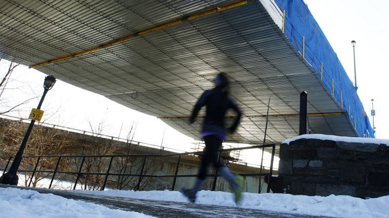 In this file image, a runner jogs beneath an overpass on the Schuylkill Banks path in Philadelphia, Pa. (AP Photo/Matt Rourke)