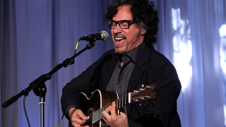 John Oates, musician and songwriter of the Hall and Oates duo, performs at Temple University's Mitten Hall after being inducted into the school's Hall of Fame. (Emma Lee/WHYY)