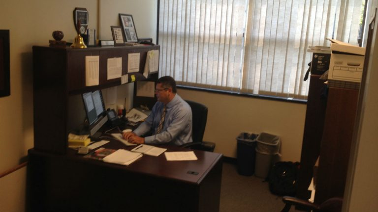 Former teacher of the year John Sell works in his office at Sussex Tech. (Avi Wolfman-Arent, NewsWorks)