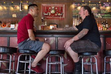 Bob Achilles (left) and Erik Boardman have a drink at Johnny Brenda's before going to bartend at another Fishtown pub. (Lindsay Lazarski/WHYY)