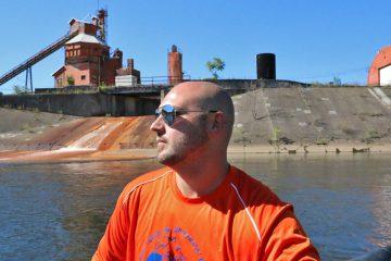 Bob Bridges of Coal Tubin' steers an inflatable boat called the shredder down the Stonycreek River in Johnstown, Pa.  (Lindsay Lazarski/WHYY)
