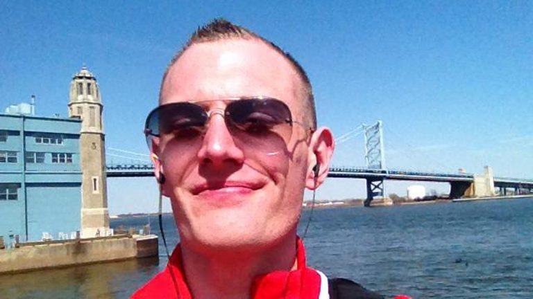 The author poses with the Benjamin Franklin Bridge in the background. (Image courtesy of Josh Kruger)