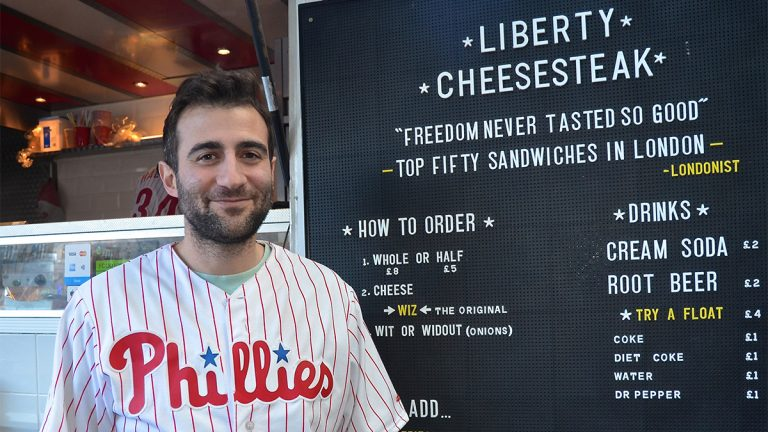 JP Teti posing in front of his Liberty Cheesesteak truck in London's historic Old Spitalfield's Market (Linn Washington Jr./for NewsWorks)
