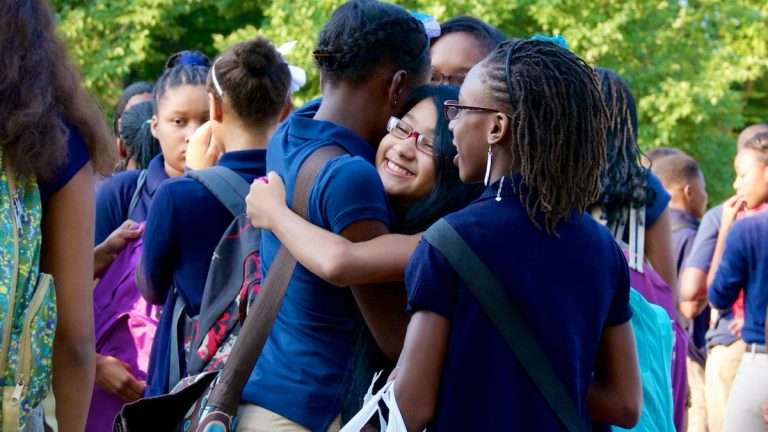 Friends greet each other on the first day of school at C.W. Henry in Mt. Airy last year. (Jana Shea/for NewsWorks)