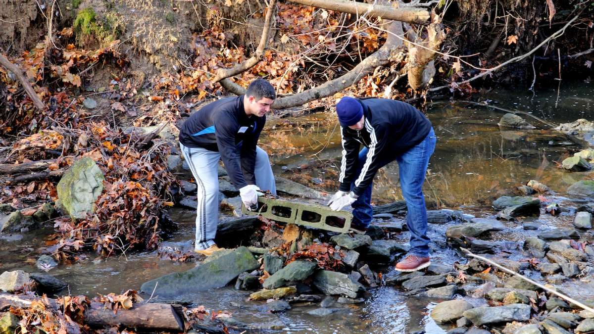 One team of volunteers cleared trash and debris from the portion of Cresheim Creek which dissects the six-acre park land.(Jana Shea/for NewsWorks)