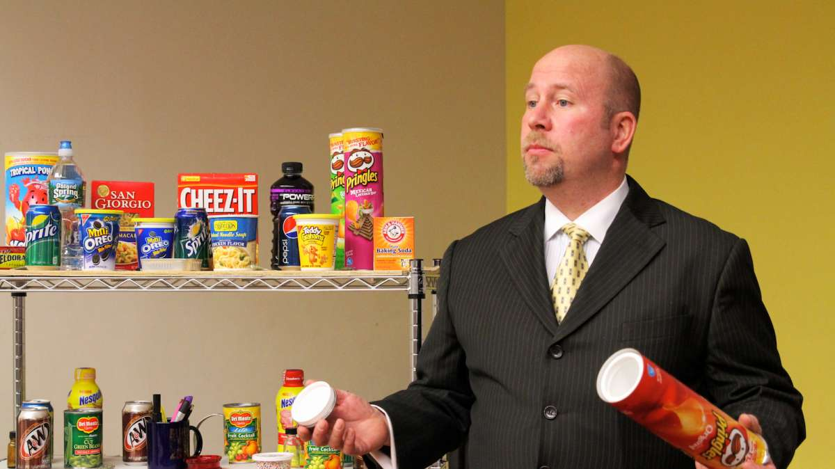 Jeff Templeton explains how a Pringles canister could actually be a drug-stash device. (Jana Shea/for NewsWorks)
