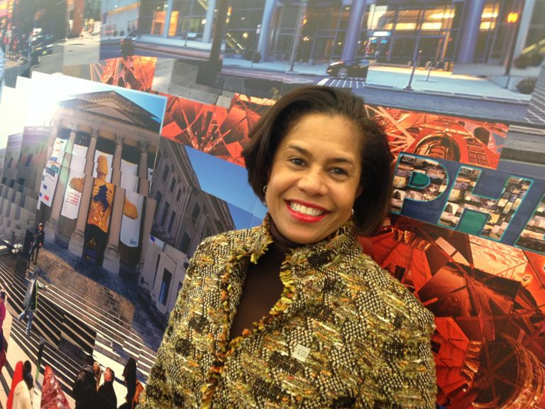 Julie Coker Graham took over the Philadelphia Conventions and Visitors Bureau on Jan. 1, marking the first time a woman and an African American has led the bureau. (Credit: Jennifer Lynn; Mural by the Phila. Mural Arts Program)