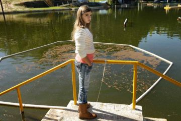 Kali Hardig stands at the edge of the lake at Willow Springs park where she was sickened by a water-borne amoeba. (AP Photo/Danny Johnston)