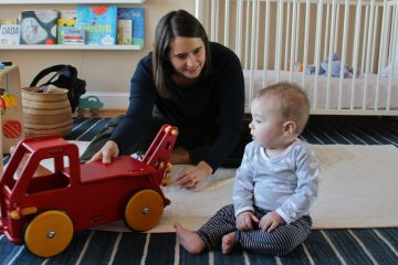 Katherine Gajewski plays with her son