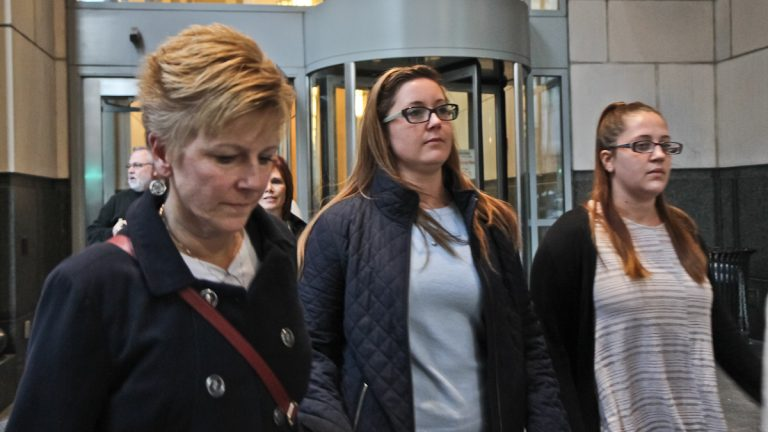 Kathryn Knott (center) exits the criminal justice center with her family and supporters after closing arguments. Knott is scheduled to be sentenced Monday (Kimberly Paynter/WHYY)
