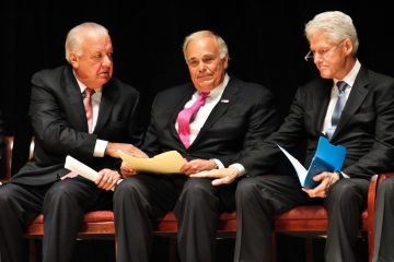 Patrick O'Connor (left) and former President Bill Clinton comfort former Pennsylvania Governor Ed Rendell at a memorial service for Lewis Katz Wednesday. (Kimberly Paynter/WHYY)