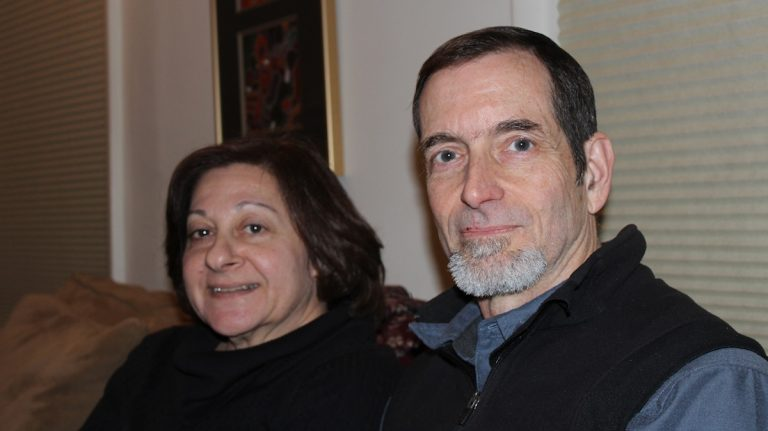 Keith Forsyth with his wife, Susan Grossinger, in their Manayunk home. (Janis Chakars/for NewsWorks)