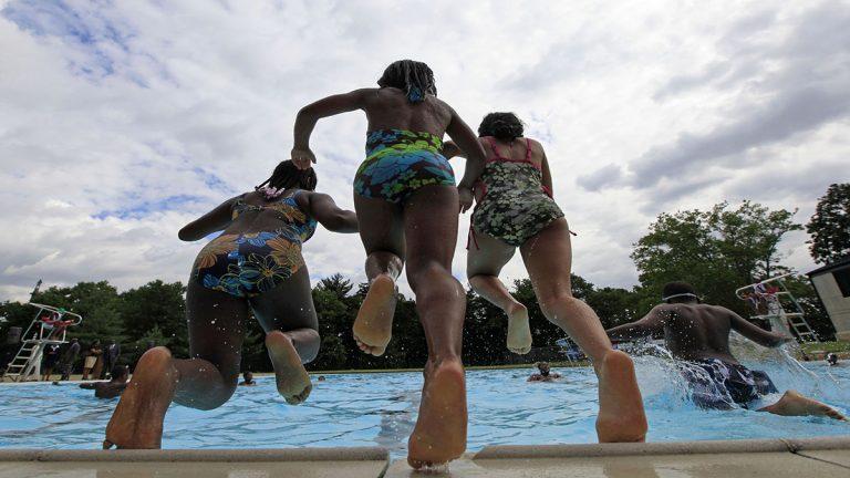 Children play at Kelly Pool in Philadelphia. (Matt Rourke/AP Photo)