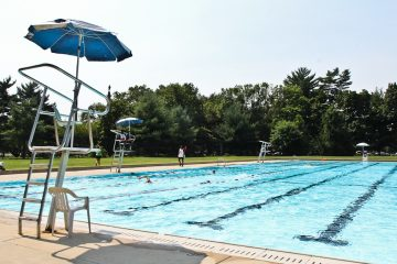 Swimmers enjoy John B. Kelly pool next to the Please Touch Museum in Fairmount Park. (Kimberly Paynter/WHYY)
