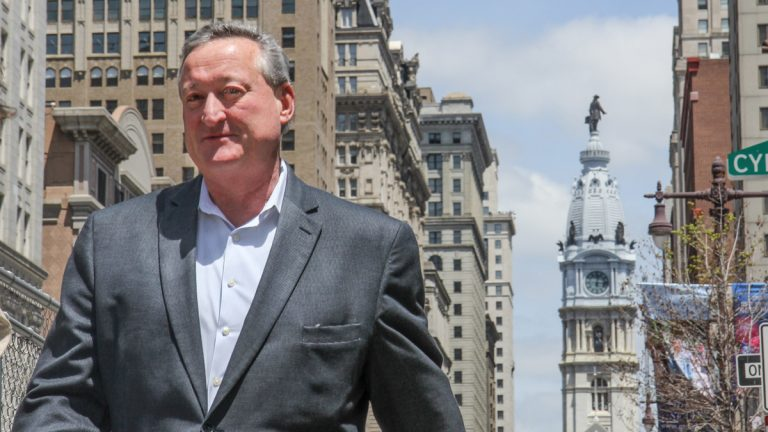 Jim Kenney walks down Broad Street towards the Broad Street Ministry. (Kimberly Paynter/WHYY)