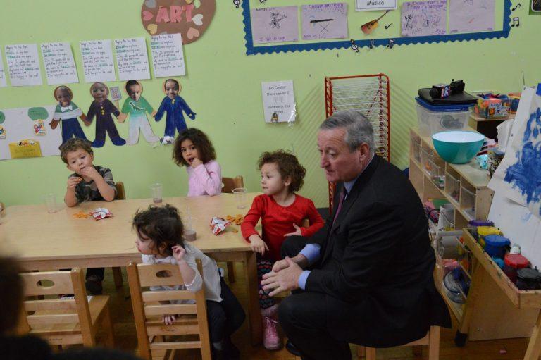 Philadelphia Mayor Jim Kenney sits with children at the Children's Playhouse pre-K in South Philadelphia. (Tom MacDonald