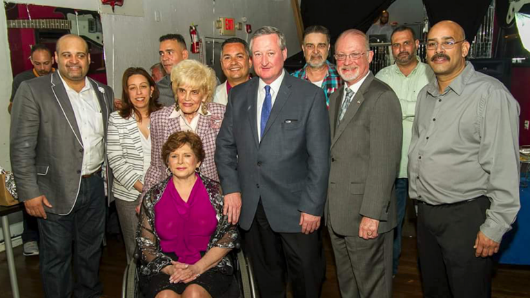 Amid a group of Democratic ward leaders, elected officials and allies, Philadelphia mayoral candidate Jim Kenney, center, stands with his hand on state Sen. Christine Tartaglione's shoulder; 7th District Council candidate Manny Morales is pictured behind Kenney to his left. (Image courtesy of Barry Caro/Diaz Campaign)
