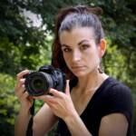 Kimberly Paynter holds up a camera