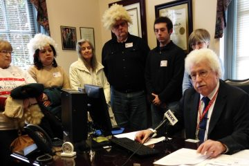 It's not a fashion statement. Supporters of Rep. John Kowalko wore wigs to express their opposition to his removal from the House Education Committee. (Shana O'Malley/ for NewsWorks)
