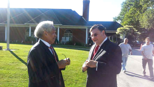 Former Mayor John Street (left) and former Councilman Dan McElhatton speak outside the funeral home. (Tom MacDonald/WHYY)