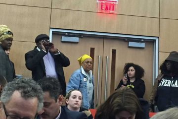 Pam Africa, center, interrupts a Philadelphia mayoral forum to chastise Lynne Abraham for signing arrest warrants for MOVE members in 1985. (Eric Walter/NewsWorks)
