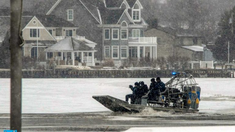 Marine crews search the frozen Toms River on March 1, 2015 after a submerged pickup truck was discovered. (Image courtesy of Riverside Signal)