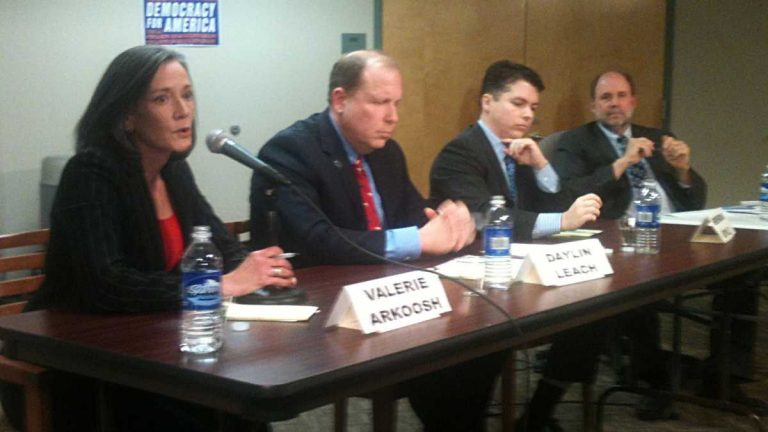 Congressional candidates Valerie Arkoosh, Daylin Leach, and Brendan Boyle join moderator Will Bunch (right) at a forum in January. (Dave Davies/WHYY, file)