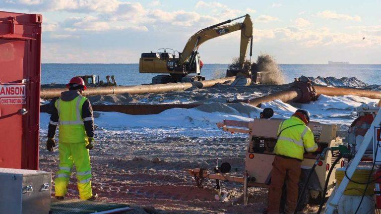 Crews working on the Long Branch beach restoration project on January 26, 2014. (Photo: Richard Huff via Jersey Shore Hurricane News)