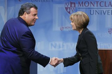 Republican New Jersey Gov. Chris Christie, left, greets Democratic challenger Barbara Buono at the start of their debate at Montclair University in Montclair, N.J., Tuesday, Oct. 15, 2013. (AP Photo/Mel Evans)