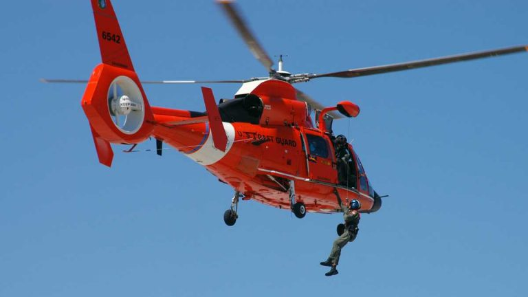 The boaters were rescued by the Coast Guard using a MH-65 Dolphin helicopter