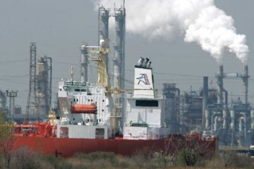 2008 file photo of an oil tanker is docked in Linden, N.J., with the Bayway refinery in background. (AP Photo/Mike Derer, file)