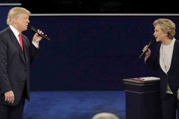 Republican presidential nominee Donald Trump and Democratic presidential nominee Hillary Clinton exchange words during the second presidential debate at Washington University in St. Louis