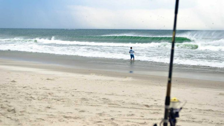 Area angler, Andrew Pero, fishes in Island Beach State Park in this 2012 photo. (Image courtesy of Jennifer Husar)