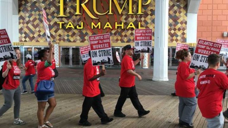 Atlantic City Unite Here Local 54 union members walk the picket line as they strike the Trump Taj Mahal (Anthony Smedile for NewsWorks)