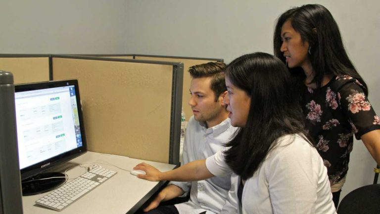 Young adults are often perplexed by insurance jargon when navigating the HealthCare.gov site.  By following study participants in real time as they shopped, researchers (from left) Mike Kaiser, Charlene Wong and Cjloe Vinoya now have recommendations for making the process easier. (Emma Lee/WHYY)