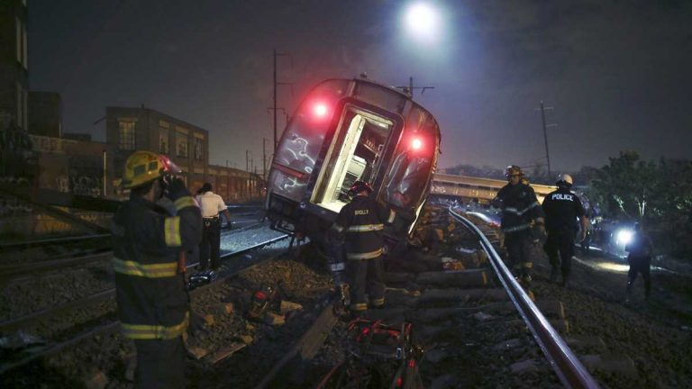 Emergency personnel work at the scene of the deadly May 12 train wreck in Philadelphia. (AP Photo/ Joseph Kaczmarek)