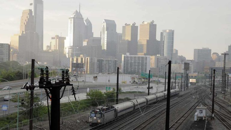 An Amtrak train travels north from 30th Street Station Monday in Philadelphia. Amtrak's Northeast Corridor trains resumed service Monday following last week's deadly derailment that killed eight people and injured more than 200 others. (Matt Slocum/AP Photo)