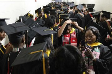 Members of Temple University's Class of 2011 wait to begin their graduation march.  (AP photo/Matt Rourke)