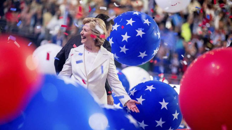 Democratic presidential candidate Hillary Clinton reacts to confetti and balloons as she stands on stage during the final day of the Democratic National Convention in Philadelphia