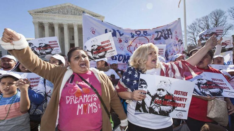 Immigration activists demonstrate at the Supreme Court in Washington earlier this year in support of President Barack Obama's executive order to grant relief from deportation in order to keep immigrant families together. (AP Photo/J. Scott Applewhite)