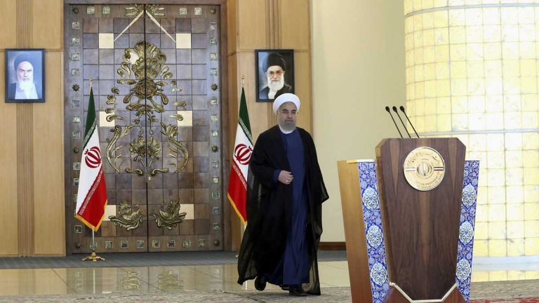 Iran's president Hassan Rouhani arrives for an address to the nation after a nuclear agreement was announced in Vienna, in Tehran, Iran. (AP Photo/Ebrahim Noroozi)