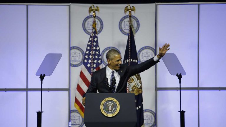President Barack Obama waves before speaking at the NAACP's 106th Annual National Convention, Tuesday in Philadelphia. (AP Photo/Matt Slocum)
