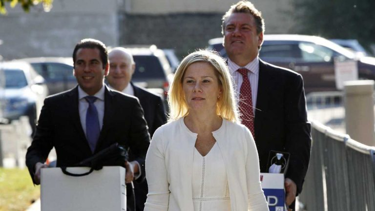 N.J. Gov. Chris Christie's former Deputy Chief of Staff Bridget Anne Kelly (center) is shown arriving at at Martin Luther King Jr. Courthouse with her attorneys for a hearing last week. (Mel Evans/AP Photo
