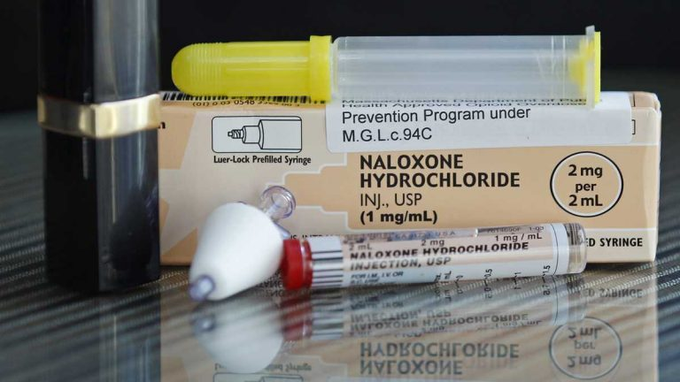 In this Tuesday Feb. 27, 2012 photo, a tube of Naloxone Hydrochloride, also known as Narcan, is shown for scale next to a lipstick container. Narcan is a nasal spray used as an antidote for opiate drug overdoses. The drug counteracts the effects of heroin, OxyContin and other powerful painkillers and has been routinely used by ambulance crews and emergency rooms in the U.S. and other countries for decades. But in the past few years, public health officials across the nation have been distributing it free to addicts and their loved ones, as well as to some police and firefighters. (AP Photo/Charles Krupa)