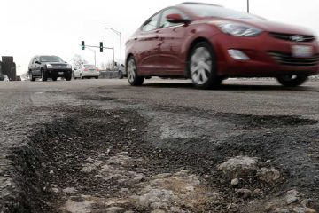 Are you willing to pay more for your car registration to help fill potholes on Philly streets? (AP Photo, file)