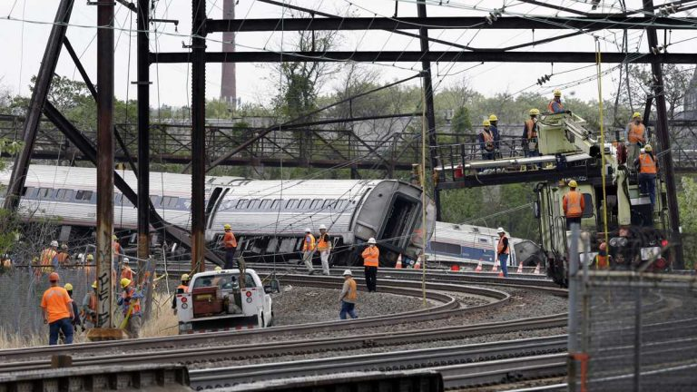 Emergency personnel walk near the scene of a deadly train wreck, Wednesday, May 13, 2015, in Philadelphia. (Mel Evans/AP Photo)