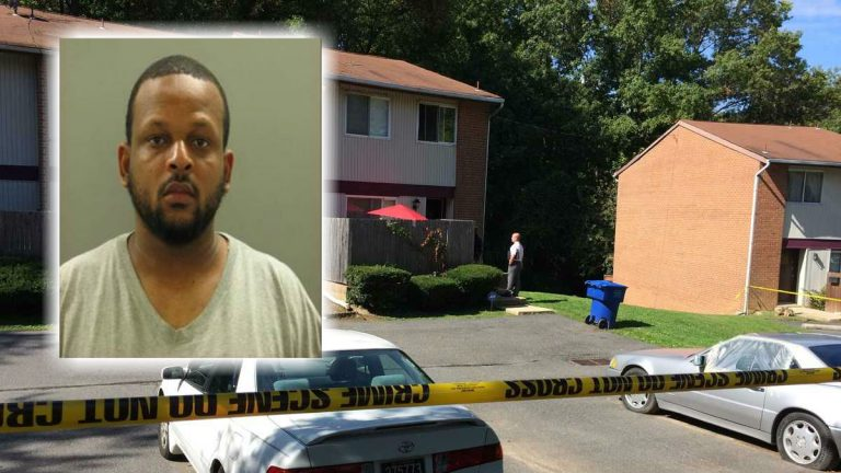 New Castle County Police at the Claymont home where a two-year-old boy was shot. (Shirley Min/WHYY)