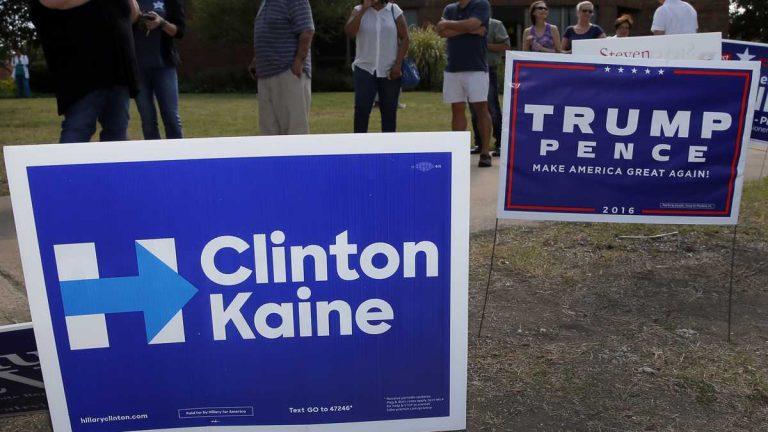 Campaign signs line a lawn near a polling place in Dallas