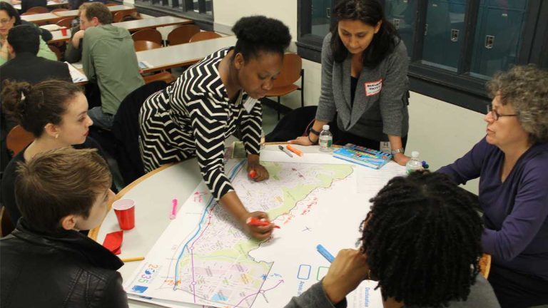 At a previous Philadelphia 2035 session,  Octavia Howell of the Philadelphia City Planning Commission recorded residents' input on the Lower Northwest District Plan. (Matthew Grady/WHYY)